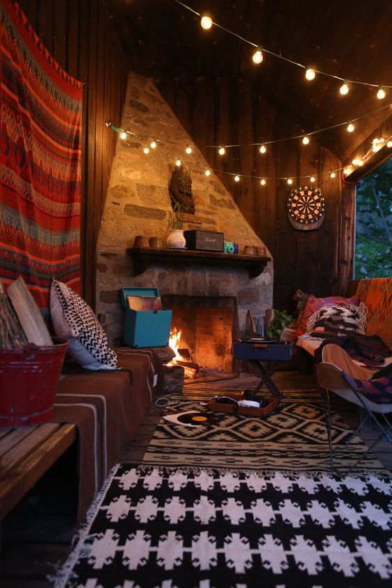 Beautiful space. Relaxed, comfy, and warm. Want the lights above and the carpet below. Love rock wall and fireplace too