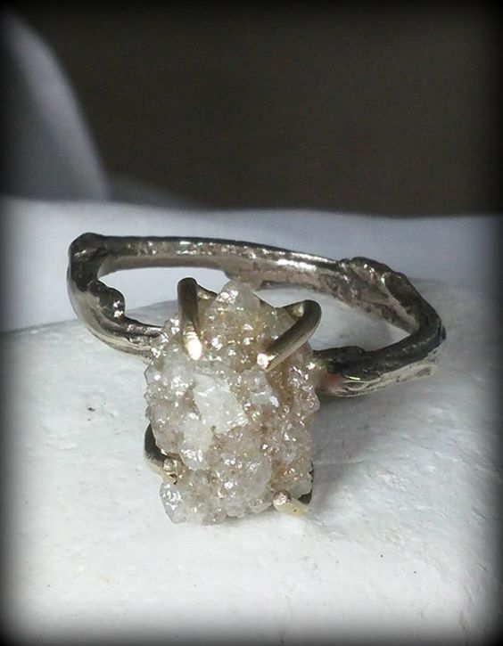 Greg, :-) I think this is my favorite. Huge raw diamond engagement ring white gold and by EarthDiamond
