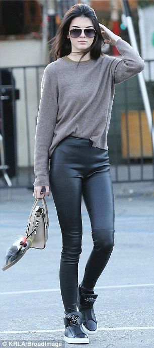 Always chic: The burgeoning model wore tight fitting leather trousers for the outing and matching trainers