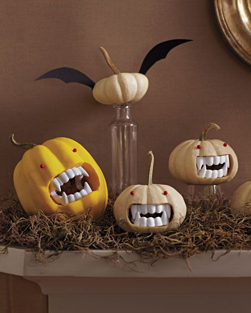 Grouped together on the mantel, Drac-o'-lantern and pals create a Transylvanian scene. Run-of-the-mill pushpins turn into devilish red eyes. via #MarthaStewart