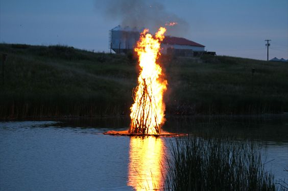 The juhannuskokko, or midsummer bonfire, burned brightly on the Maple River in Frederick. The bonfire is a midsummer tradition in Finland and now in Frederick. Photo courtesy fredericksd.com    Story: Festivals bring small towns roaring to life