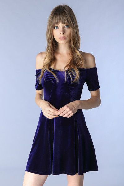 This faux velvet skater dress comes in a midnight blue color that is sure to compliment anyones coloring. Off the shoulder short sleeves. 92% Polyester 8% Spandex Model is wearing size S Measurements:
