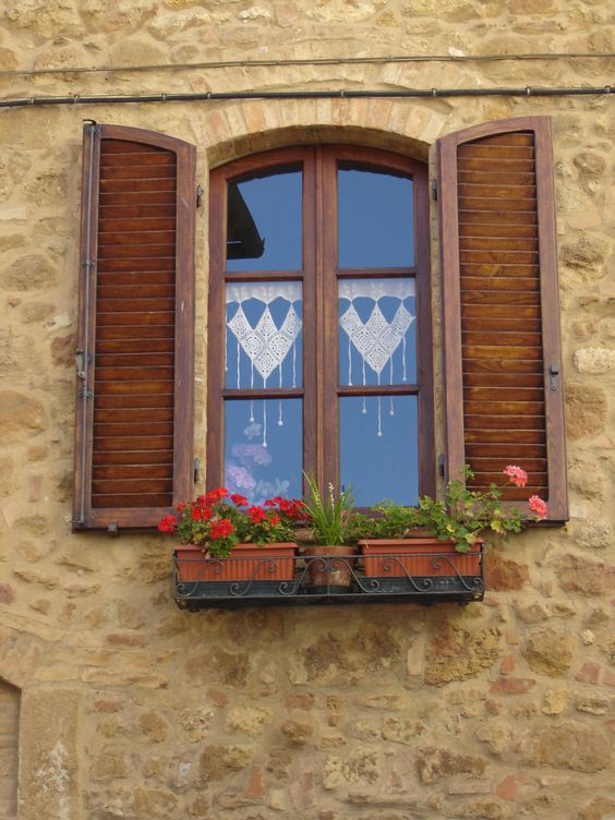Window in Pienza,province of Siena ,heart shaped lace,Tuscany region Italy