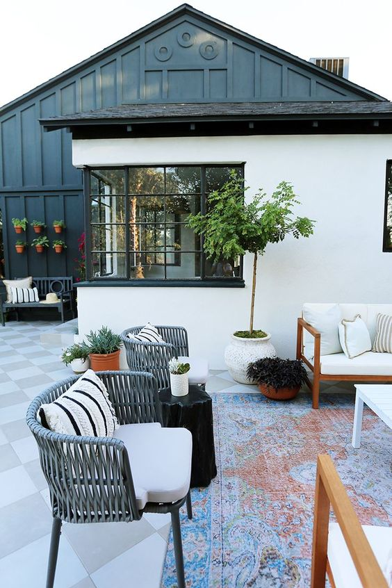 Outdoor patio design with beautiful black exterior home