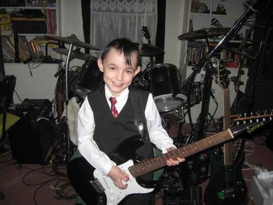 This is my youngest son Kameron, He loves to play the guitar and also the drums,He has a ear for music just like his father.