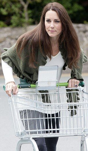 Doing the weekly shop, Duchess? Kate joins the rest of the supermarket shoppers by grabbing a trolley: