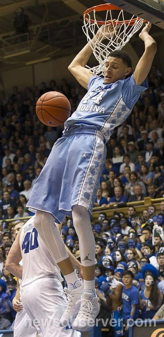 North Carolina's Justin Jackson (44) get a dunk over Duke's Marshall Plumlee (40) during the second half. Jackson scored 13 points in the Tar Heels 76-72 victory.