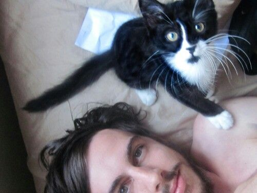 Cute cat. Cute guy. Because men with cats are always sexier.