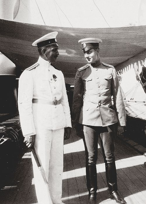 Grand Duke Dmitri Pavlovich of Russia with the commander of the Imperial Yacht Standart, Nikolai Sablin.