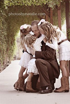 Daddy's little girls! Such a cute picture