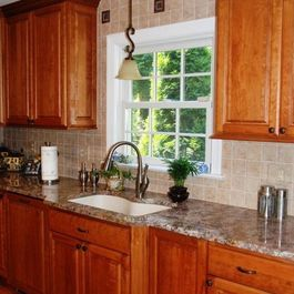 Kitchen Remodel with Cherry Cabinets and Tile Backsplash by Hatchett Design/Remodel