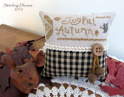 Real acorns used for cute finishing touch.  Stitching Dreams: Stitching a Scurry of Squirrels