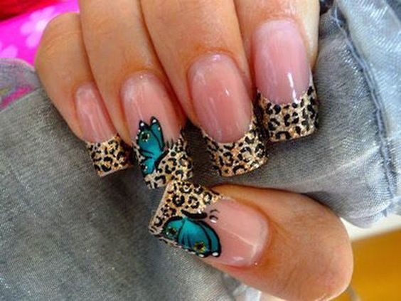 Try out wild and exotic looking butterfly themed nail art! This design sports a leopard print French tip topped with a green blue colored butterfly. Show off the animalistic side of you.