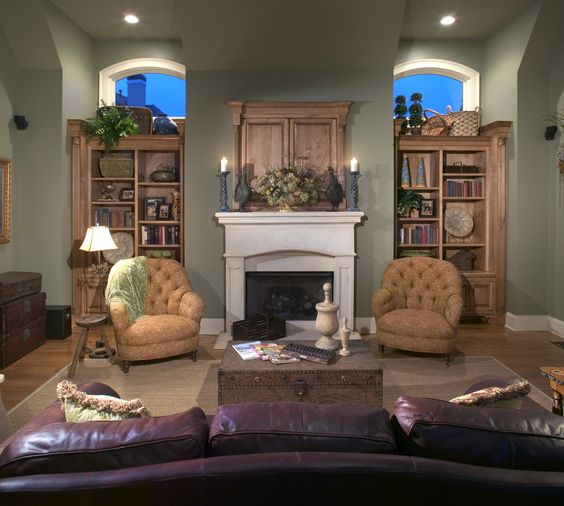Step inside 1990 with this traditional living room. They have a white stone fireplace mantel, English country furniture and green painted walls, which is a hot color in 2014. #green #paintedwalls #traditional #livingroom