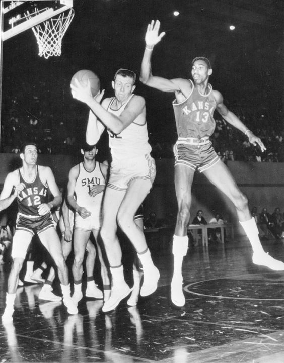 Wilt Chamberlain.  That dude with the ball looks scared, he knows who is behind him. 1958