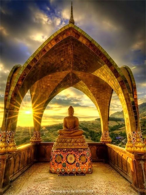 Sunset behind Buddha sculpture at Wat Phra Kaew