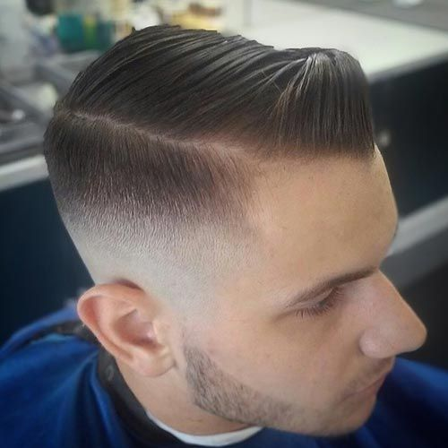 Bald fade short beard and slicked back modern pompadour credit to