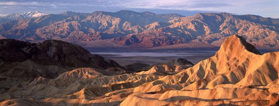 In this below-sea-level basin, steady drought and record summer heat make Death Valley a land of extremes. Yet, each extreme has a striking contrast. Towering peaks are frosted with winter snow. Rare rainstorms bring vast fields of wildflowers. Lush oases harbor tiny fish and refuge for wildlife and humans. Despite its morbid name, a great diversity of life survives in Death Valley.