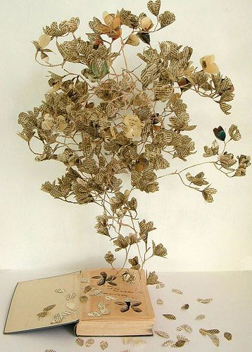 altered book with branches and petals
