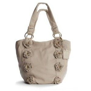 crown vintage rosette tote. my most favorite bag i've ever owned...and then like an idiot i returned it because it was a little on the heavy side. have not been able to find a bag to match the love i have for this bag but of course it's sold out everywhere