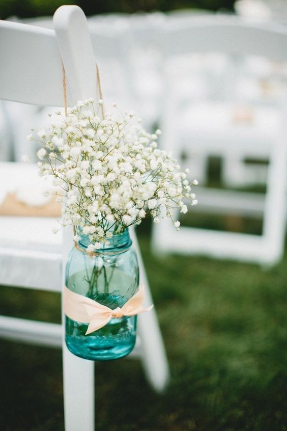 Baby's Breath is a popular and very affordable flower for spring and summer weddings. Consider blue mason jars, ribbon to match the bridal colors and Baby's Breath for aisle markers.: