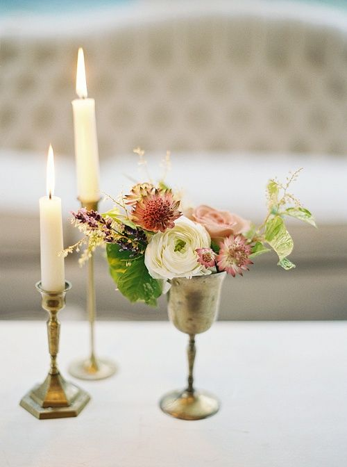 Our Collection of vintage Brass Candlesticks and silver Goblets are always and elegant choice for tabletop decor. I also spy our Fulton Sofa looking pretty in the background Marisa & Scott's wedding Reception! Florals by Fluer Du Jour, Planning by Type A Society, Image by Laura Gordon Photography