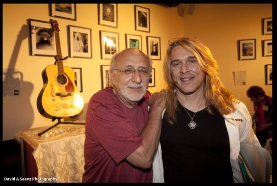 "It's Peter Yarrow of Peter, Paul & Mary, with Rick Droit... Well...  ""Puff, The Magic Dragon, Lived By The Sea; & Frolicked In The Autumn Mist, In A Land Called Hanaleee...""  Ha Ha... I'll bet he gets tired of that."