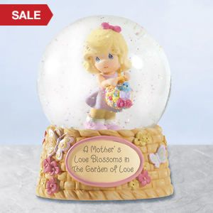 """THIS MUSICAL WATER GLOBE HAS A THEME """" A MOTHER'S LOVE BLOSSOMS IN THE GARDEN OF LOVE."""" IT'S BY PRECIOUS MOMENTS. IT PLAYS THE TUNE """" ALWAYS IN MY HEART."""""""