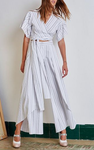 This high rise **Alexis** pant features a wide leg silhouette with an asymmetric…