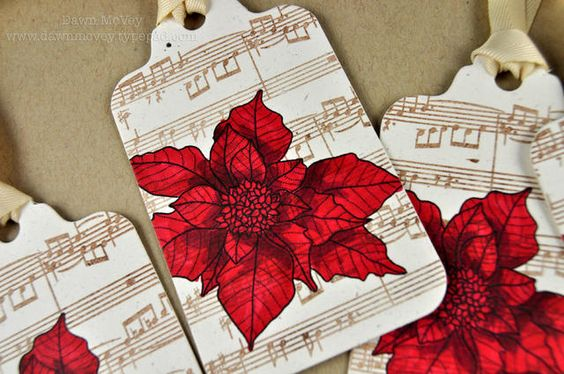 Stamps: Background Basics: Sheet Music, Year of Flowers: Poinsettia; Ink: dark chocolate, true black; Other: tag sale #1 die, fine linen topnotch twill ribbon, Copic markers.