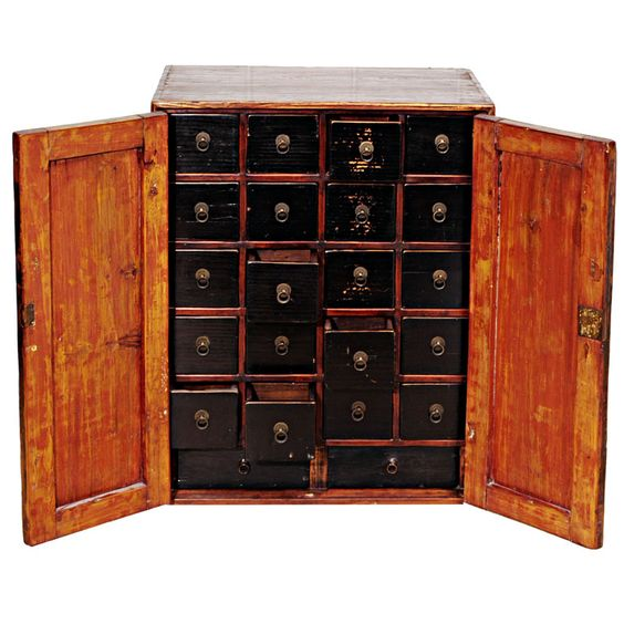 Apothecary Chest  China  19th Century  Small Medicine Cabinet with double doors and original hardware. Each drawer is separated into multiple sections