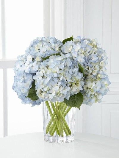Blue white and yellow flower arrangements