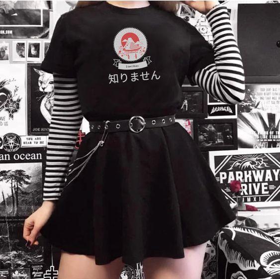 Girl in black shirt and skirt