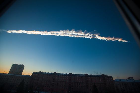 A meteor left a trail of smoke across the sky as it passed over Chelyabinsk, Russia, Friday.