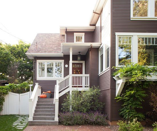 """Slate-gray siding makes bright-white trim stand out."" I love this...I would paint the front door red."