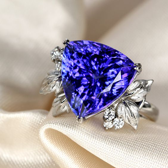 tanzanite ring. Vivid dark Tanzanite beats Amethyst every single day of the week. Unless you can find top notch brazilian amethyst