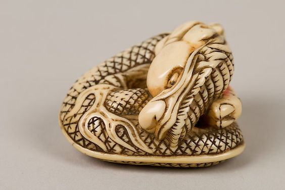 Netsuke of Coiled Dragon Enclosing a Pearl Date: late 18th century Culture: Japan Medium: Ivory Dimensions: H. 1 3/4 in. (4.4 cm); W. 1 1/2 in. (3.8 cm)