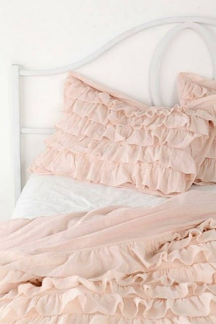 pale pink ruffled bedding...so sweet.
