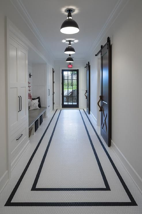 Black And White Hexagon Floor Tiles In A Galley Mudroom Feature Two Black Borders That Visually Creat Marble Flooring Design White Marble Floor Hallway Designs