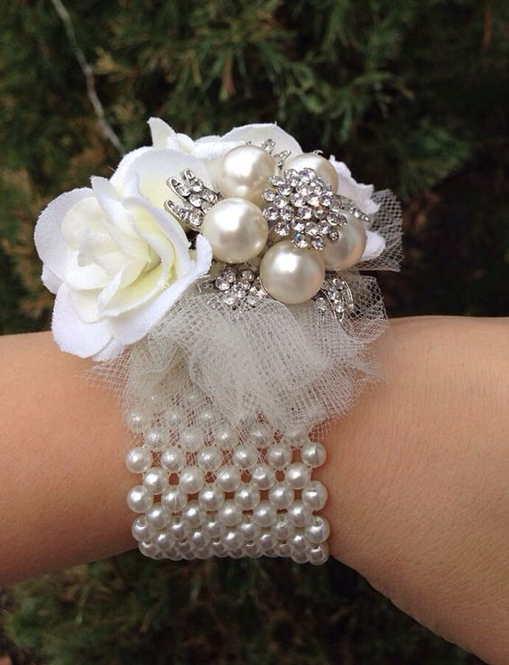 Beautiful pearl brooch wrist corsage. Great for Mother of the Bride and Groom! Made to order  Can make requests for different color flowers