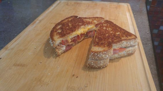 Pepper jack colby jack bacon and tomato on multi grain. Oh so delicious #grilledcheese #food #yum #foodporn #cheese #sandwich #recipe #lunch #foodie
