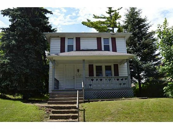 Nice home in town!  Home features 3 bedrooms, 1.5 baths, 1232 square feet, covered front porch, detached garage out back with access from alley, and much more!  Call today!