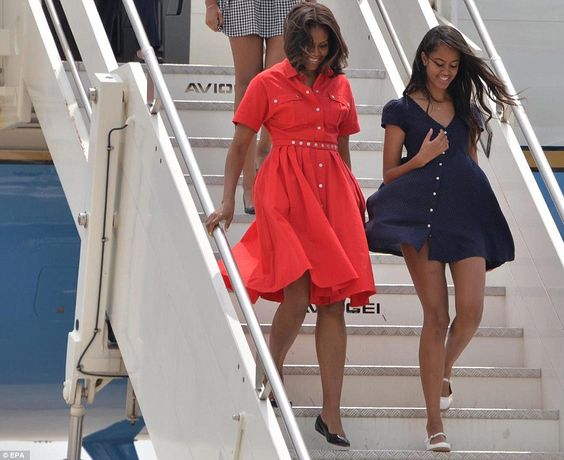 Michelle Obama nearly caught out by wind as she arrives with daughters Malia and Sasha in Italy   Daily Mail Online