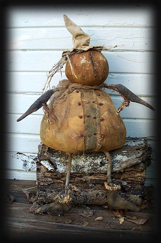 primitve pumpkin-man with some crow friends  !