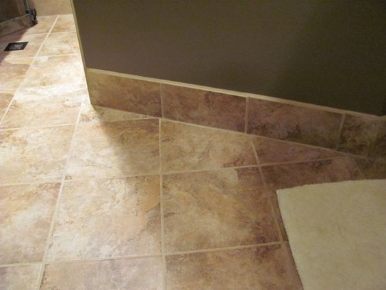Alternative to wood base use the coordinating tile that for Wood floor alternatives