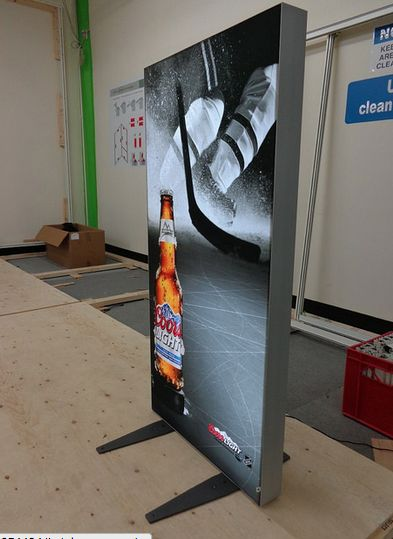Backlit portable modular stand, works great in large or small booth spaces.