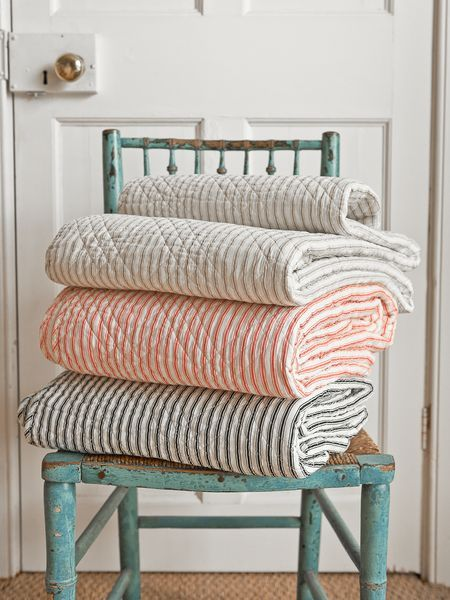 Quilted ticking stripe coverlets...perfect for your beach cottage! @TheDailyBasics ♥♥♥