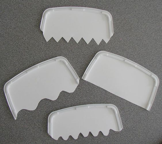 DIY SAND COMBS: Use plastic lids of ice-cream containers. First cut in half with a strong pair of scissors. Next different patterns were cut along one edge of each comb – wavy, jagged, straight and curvy.