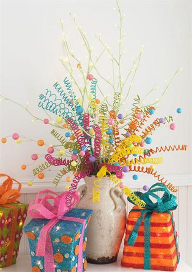 Cute centerpiece for party..fun display with curled pipe-cleaners - so colorful AND inexpensive~ would be cute with red, white and green for christmas or red white and blue for the 4th
