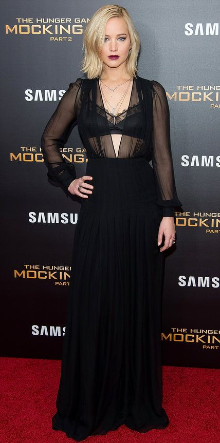 Jennifer Lawrence in a racy plunging black Schiaparelli Couture gown.
